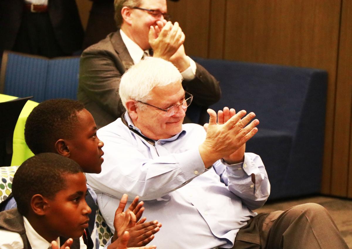 Dick Fetter claps for speaker