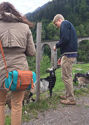 Student Feeding Goat